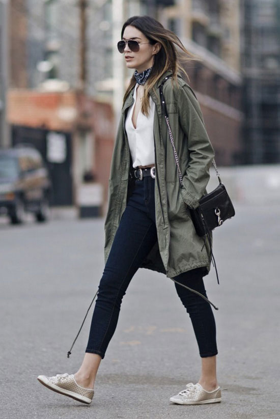 Street Style - The Top Blogger Looks Of The Week: Fashion blogger 'Thrifts & Threads' wearing an oilve utility jacket, a white v-neck top, a black bandana, dark crop jeans, gold sequin sneakers, a western belt, a black shoulder bag and aviator sunglasses