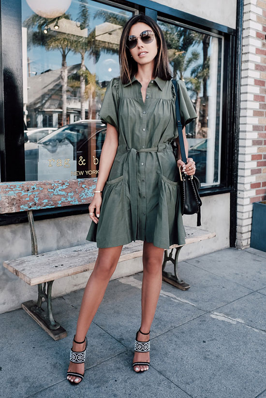 street style - The Top Blogger Looks Of The Week: Fashion blogger 'Viva Luxury' wearing a military green short sleeve shirt dress, black embroidered heeled sandals, oversized sunglasses and a black tassel saddle bag. summer outfits, beach outfits, getaway outfits, party outfits