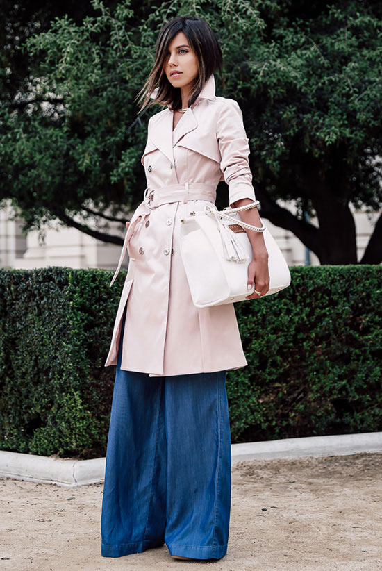 Street Style - The Top Blogger Looks Of The Week: Fashion blogger 'Viva Luxury' wearing a blush trench coat, a white v-neck cami top, chambray palazzo pants, nude platform sandals and a white handbag. Spring outfit, fall outfit, casual outfit.