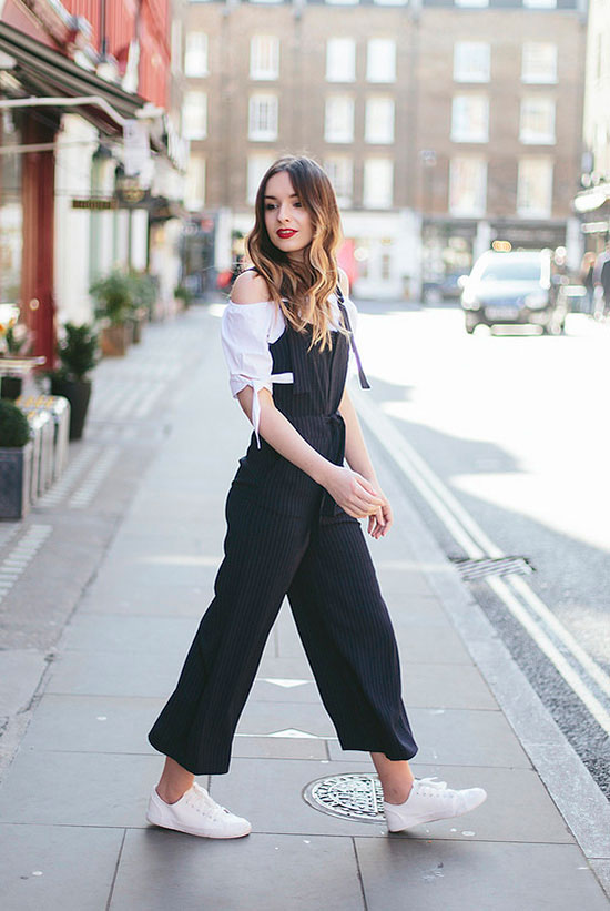 street style - The Top Blogger Looks Of The Week: Fashion blogger 'What Olivia Did' wearing black pinstripe culotte overalls, white sneakers and a white off shoulder top. Spring outfits, summer outfits, comfy outfits, athleisure, casual outfits
