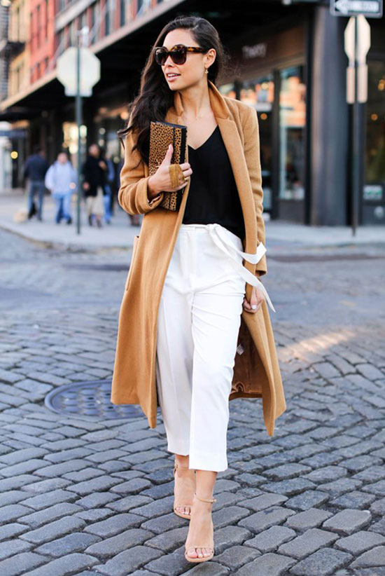 spring work outfits - 30 Spring Work Outfits To Try Right Now: Fashion Blogger 'With Love From Kat' wearing a camel coat, a black v-neck cami top, white ankle pants, nude heeled sandals, brown sunglasses and a leopard print clutch