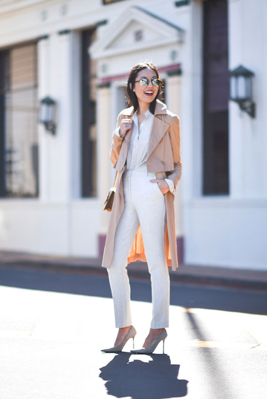 20 Ways To Style Your Favorite Trench Coat: Fashion Blogger '9 to 5 Chic' wearing a beige trench coat, a white shirt, white skinny jeans, light grey heels, mirror sunglasses and a light brown shoulder bag. Trench coat outfit, spring outfit, fall outfit, work outfit, office outfit, neutral outfit, neutral tone outfit, street chic style, casual outfit.
