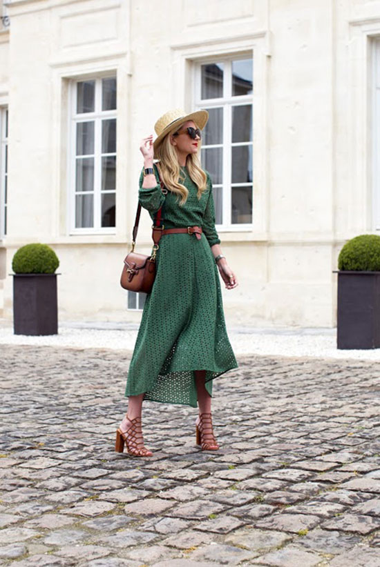 Street Style - The Top Blogger Looks Of The Week: Fashion Blogger 'Atlantic-Pacific' wearing a green lace long sleeve maxi dress, brown caged heeled sandals, a brown belt, black sunglasses, a straw boater hat and a brown shoulder bag. Summer outfit, casual outfit, street chic style.