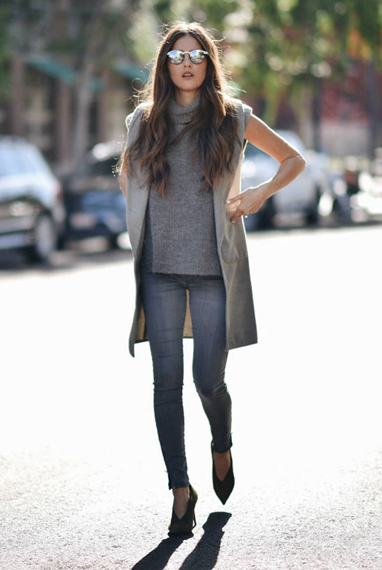 Street Style - The Top Blogger Looks Of The Week: Fashion Blogger 'Blank Itinerary' wearing a grey sleeveless coat, a grey turtleneck sleeveless tunic, grey jeans, mirror sunglasses and grey heels. Fall outfit, casual outfit, shades of grey, all grey outfit, street chic style.