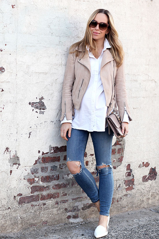 Street Style - The Top Blogger Looks Of The Week: Fashion blogger 'Brooklyn Blonde' wearing a blush leather jacket, a white long shirt, distressed skinny jeans, white pointy toe loafers, pink sunglasses and a blush shoulder bag. Spring outfit, casual outfit, comfy outfit, street chic style.