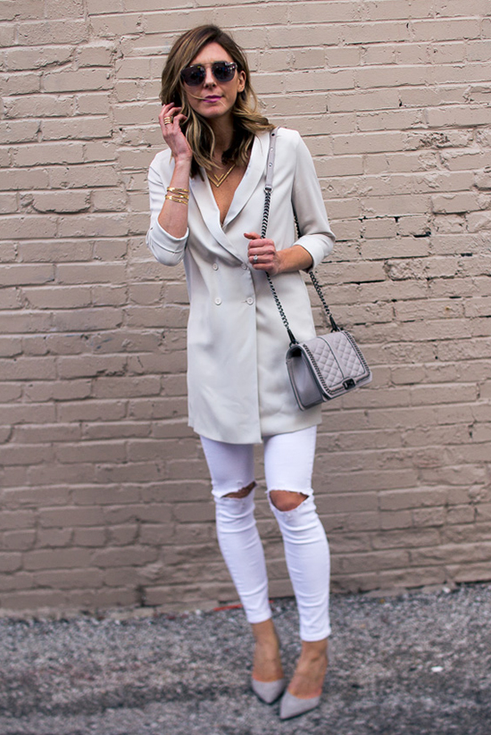 Street Style - The Top Blogger Looks Of The Week: Fashion blogger 'Cella Jane' wearing a cream double breasted long blazer, white skinny jeans, grey heels, black sunglasses and a grey shoulder bag. Casual outfit, neutral tone outfit, party outfit, night out outfit, street chic style.