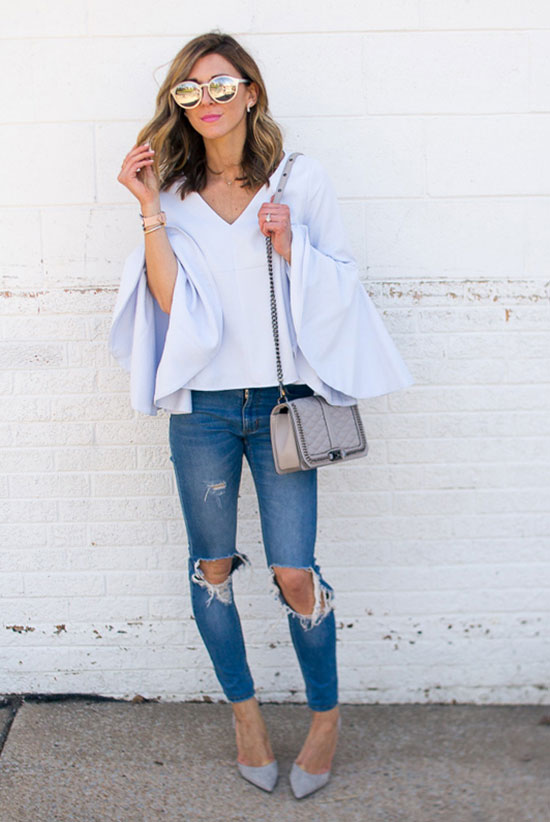 Street Style - The Top Blogger Looks Of The Week: Fashion blogger 'Cella Jane' wearing a light blue bell sleeve blouse, distressed skinny jeans, light grey heels, silver mirror sunglasses and a white shoulder bag. Spring outfit, summer outfit, night out outfit, casual outfit, street chic style.