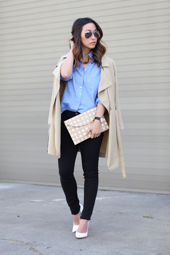 20 Ways To Style Your Favorite Trench Coat: Fashion Blogger 'Crystalin Marie' wearing a beige trench coat, a light blue shirt, black skinny jeans, white heels, silver aviator sunglasses and a beige clutch. Trench coat outfit, work outfit, office outfit, casual outfit, spring outfit, fall outfit, street chic style.
