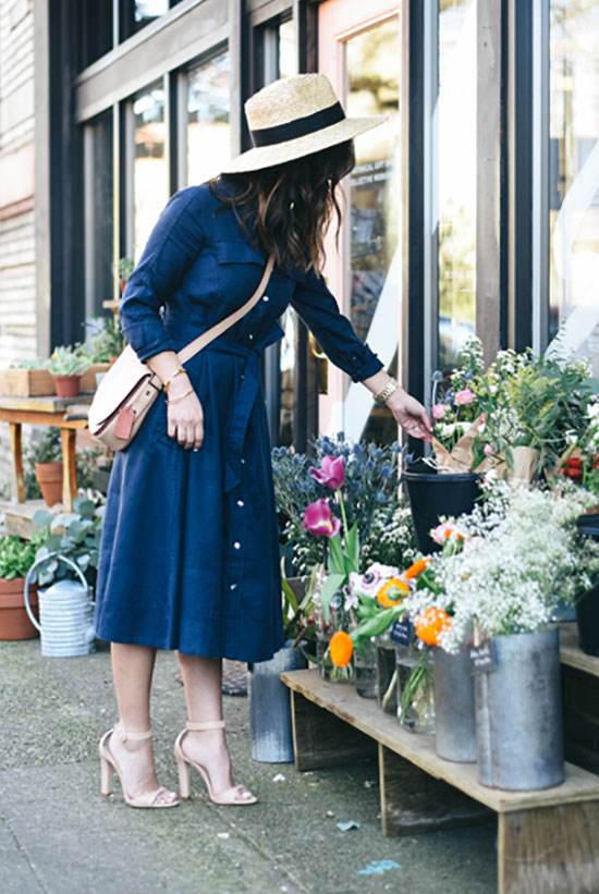 Street Style - The Top Blogger Looks Of The Week: Fashion blogger 'Crystalin Marie' wearing a boater hat, a denim long sleeve shirt dress, nude ankle strap heeled sandals and a nude shoulder bag. Spring outfit, summer outfit, casual outfit.