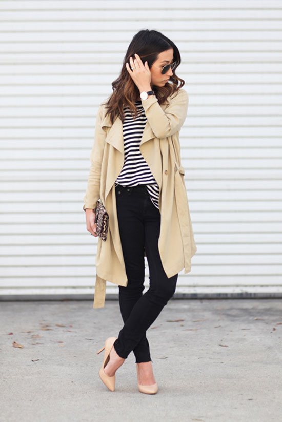 20 Ways To Style Your Favorite Trench Coat: Fashion Blogger 'Crystalin Marie' wearing a beige trench coat, a stripe t-shirt, black skinny jeans, nude heels, aviator sunglasses and a leopard print clutch. Trench coat outfit, spring outfit, fall outfit, night out outfit, work outfit, street chic style.