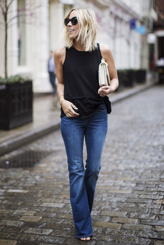 Street Style - The Top Blogger Looks Of The Week: Fashion Blogger 'Damsel In Dior' wearing a black sleeveless peplum top, flare jeans, black heeled sandals, black sunglasses and a white clutch. Summer outfit, casual outfit, simple outfit, easy outfit.