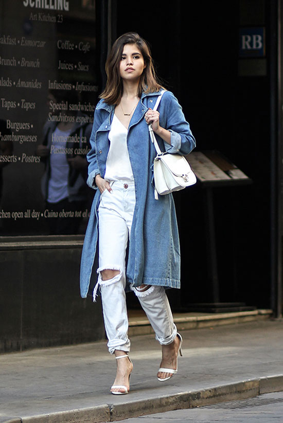 Street Style - The Top Blogger Looks Of The Week: Fashion blogger 'Fake Leather' wearing a denim trench coat, a white cami top, white distressed boyfriend jeans, white ankle strap heeled sandals and a white shoulder bag. Spring outfit, summer outfit, casual outfit, street chic style.