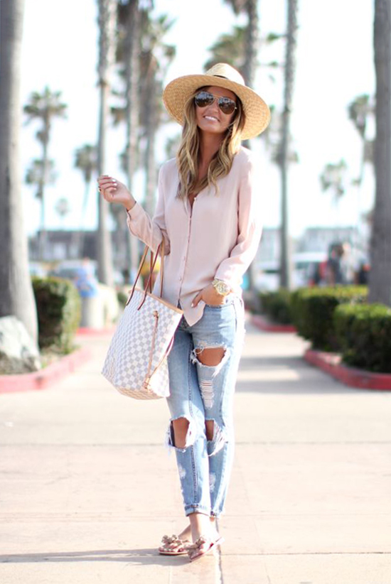 Street Style - The Top Blogger Looks Of The Week: Fashion blogger 'For All Things Lovely' wearing a blush blouse, a straw fedora, light distressed skinny jeans, nude sandals, aviator sunglasses and a neutral handbag. Summer outfit, comfy outfit, travel outfit, vacation outfit, casual outfit, easy outfit.
