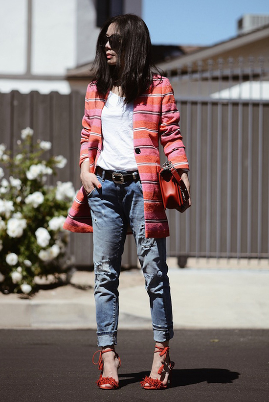 Street Style - The Top Blogger Looks Of The Week: Fashion blogger 'Hallie Daily' wearing a pink and orange stripe long blazer, a white t-shirt, boyfriend jeans, a black belt, red lace-up sandals, black sunglasses and a red shoulder bag. Casual outfit, night out outfit, summer outfit, spring outfit, street chic style.