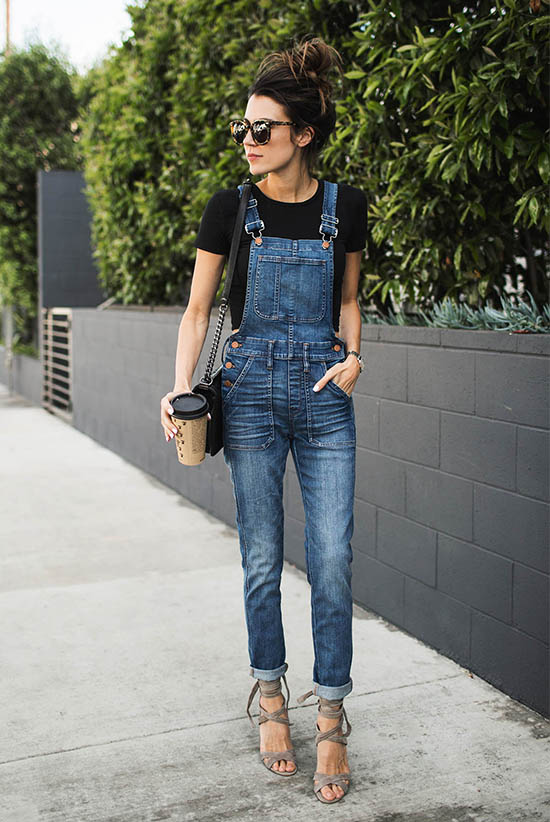 Street Style - The Top Blogger Looks Of The Week: Fashion blogger 'Hello Fashion Blog' wearing a black t-shirt, denim overalls, grey lace-up sandals, brown sunglasses and a black shoulder bag. Casual outfit, summer outfit, street chic style.