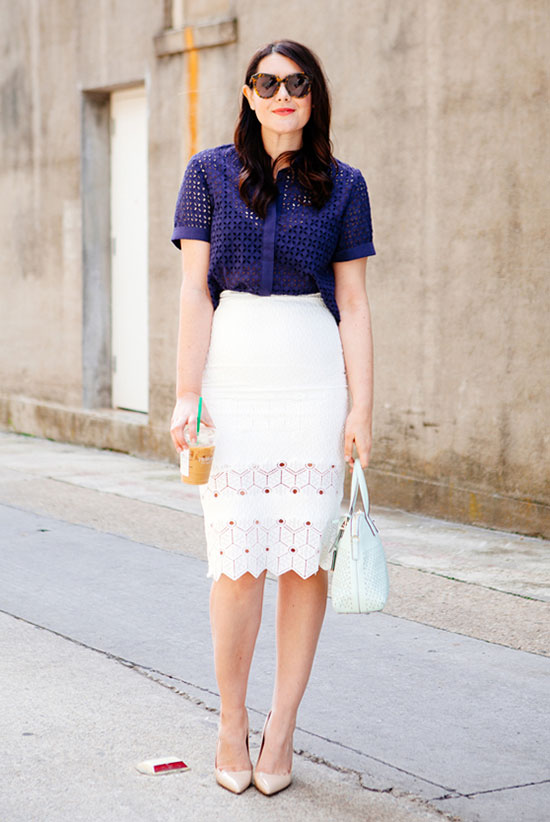 Street Style - The Top Blogger Looks Of The Week: Fashion Blogger 'Kendi Every Day' wearing a blue lace short sleeve shirt, a white lace insert pencil skirt, nude heels, brown sunglasses and a white handbag. Summer outfit, spring outfit, work outfit, office outfit, night out outfit, street chic style.
