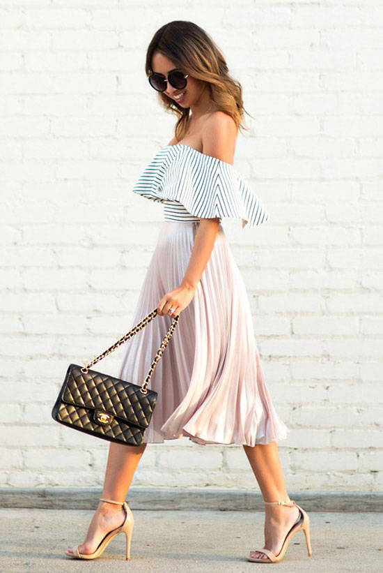 Street Style - The Top Blogger Looks Of The Week: Fashion blogger 'Lace & Locks' wearing a stripe off shoulder top, a blush pleated midi skirt, nude ankle strap heeled sandals, black round sunglasses and a black shoulder bag. Spring outfit, summer outfit, party outfit, date night outfit, night out outfit.