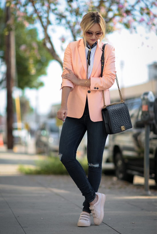 Street Style - The Top Blogger Looks Of The Week: Fashion blogger 'Late Afternoon' wearing a neon blush blazer, a white shirt, a black bandana, dark skinny jeans, pale pink sneakers, pink sunglasses and a black shoulder bag. Casual outfit, comfy outfit, spring outfit, sneakers outfit, athleisure.