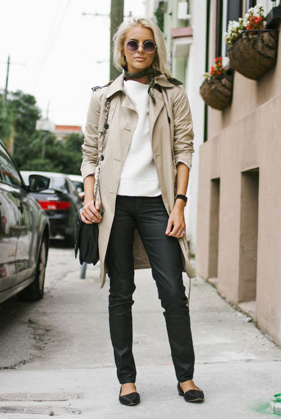 20 Ways To Style Your Favorite Trench Coat: Fashion Blogger 'Like The Yogurt' wearing a beige trench coat, a white sweatshirt, black leather pants, black flats, a black bandana, round sunglasses and a black shoulder bag. Trench coat, street style, fall outfit, work outfit, casual outfit, comfy outfit, boho chic outfit.