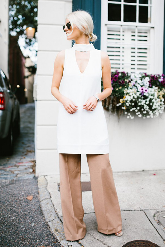 Street Style - The Top Blogger Looks Of The Week: Fashion blogger 'Like The Yogurt' wearing a white keyhole mini dress, light brown wide leg pants, nude heeled sandals and round sunglasses. Casual outfit, summer outfit, vacation outfit, comfy outfit, 70's outfit, street chic style.