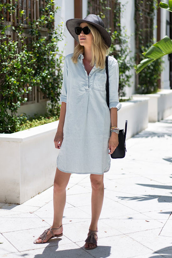 Street Style - The Top Blogger Looks Of The Week: Fashion Blogger 'Little Blonde Book' wearing a light chambray dress, taupe tassel sandals, black sunglasses, a black straw fedora and a black shoulder bag. Summer outfit, comfy outfit, casual outfit, beach outfit, getaway outfit, vacations outfit.