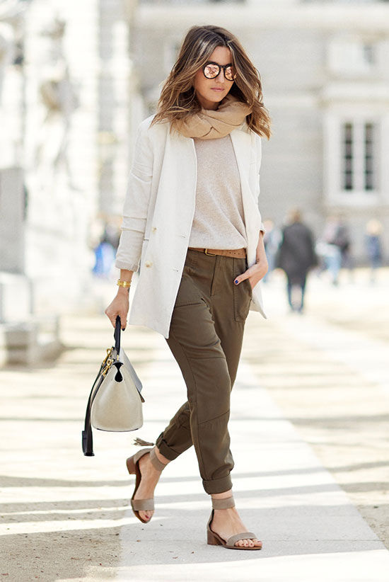 Street Style - The Top Blogger Looks Of The Week: Fashion Blogger 'Lovely Pepa' wearing a white blazer, a cream light sweater, a brown belt, olive joggers, taupe suede low heel sandals, mirror sunglasses, a blush wrap and a white handbag. Spring outfit, comfy outfit, travel outfit, vacation outfit, casual outfit.