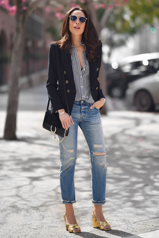 Street Style - The Top Blogger Looks Of The Week: Fashion blogger 'Lucy's Whims' wearing a black military blazer, a black and white stripe shirt, distressed crop jeans, gold block heel sandals, black sunglasses and a black shoulder bag. Spring outfit, summer outfit, casual outfit, street chic style.