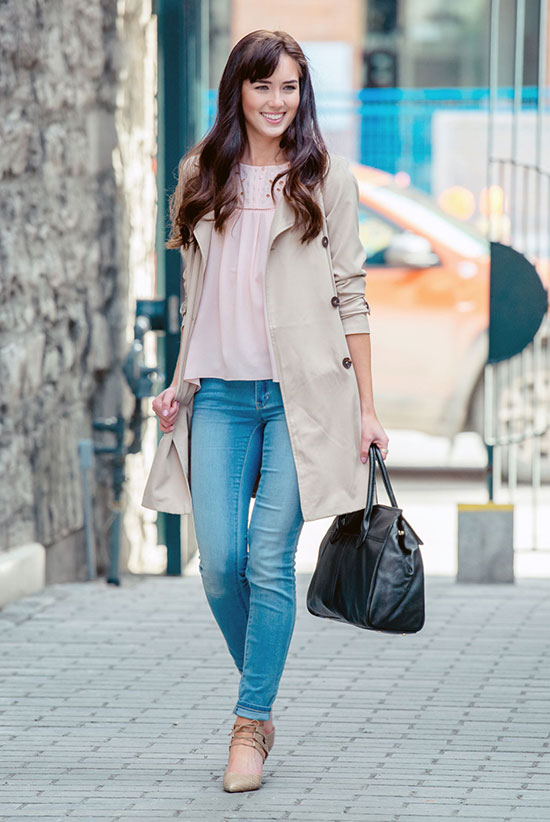 20 Ways To Style Your Favorite Trench Coat: Fashion Blogger 'Marie's Bazaar' wearing a beige trench coat, a pale pink blouse, light skinny jeans, nude lace up heels and a black handbag. Trench coat outfit, spring outfit, casual outfit, street chic style.
