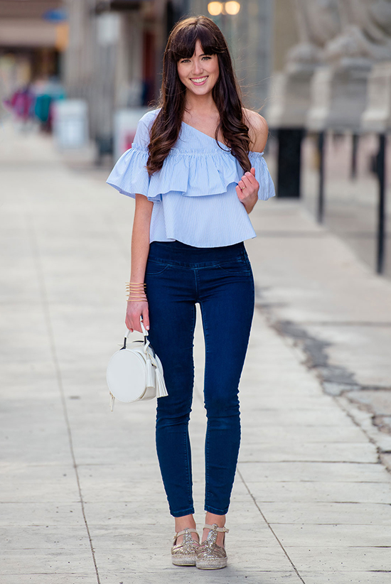 Street Style - The Top Blogger Looks Of The Week: Fashion blogger 'Marie's Bazaar' wearing a pale blue ruffle top, skinny jeans, gold espadrilles and a white handbag. Summer outfit, casual outfit, beach outfit, vacation outfit.