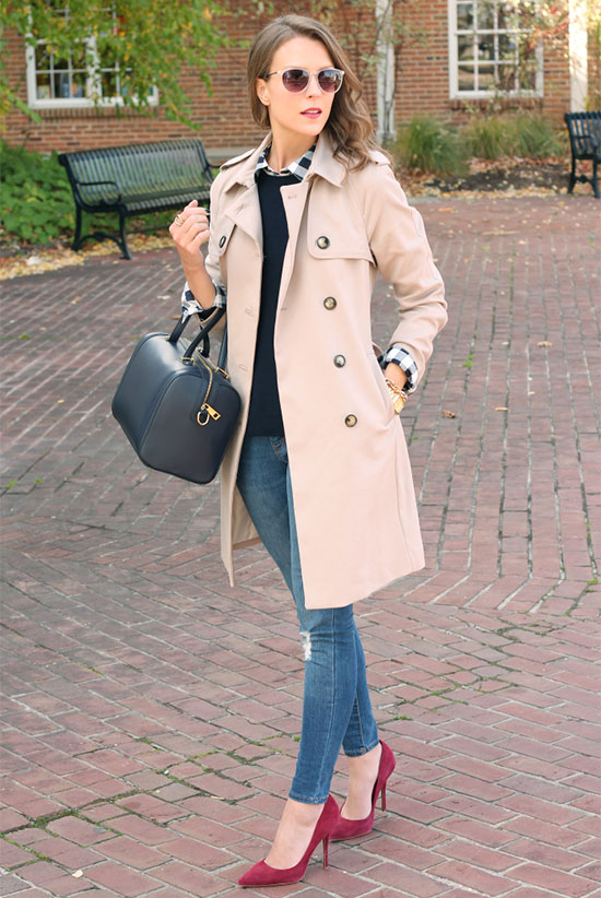 20 Ways To Style Your Favorite Trench Coat: Fashion Blogger 'Penny Pincher Fashion' wearing a beige trench coat, a black check print shirt, a black sweater, skinny jeans, red suede heels, beige sunglasses and a black handbag. Trench coat outfit, fall outfit, casual outfit, street chic style.