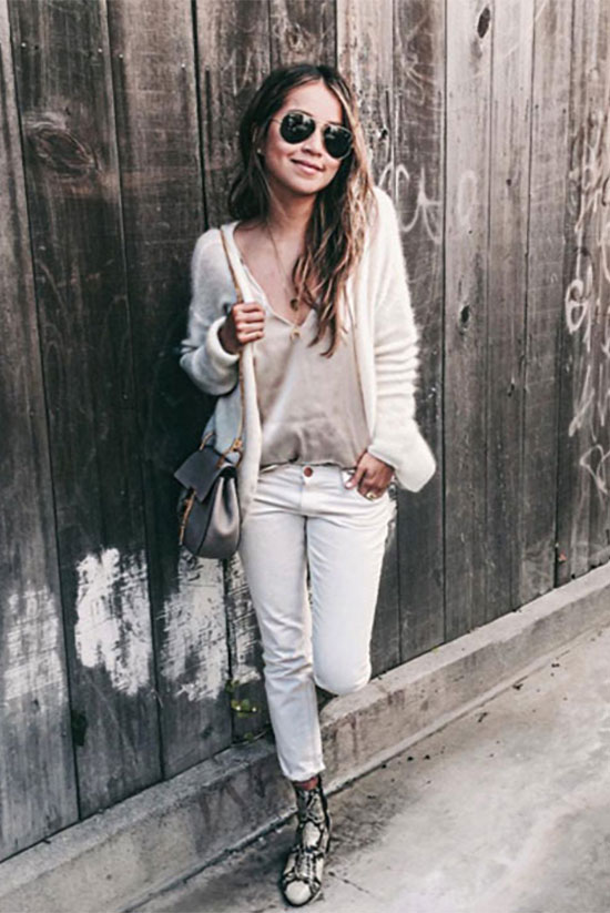 Street Style - The Top Blogger Looks Of The Week: Fashion Blogger 'Sincerely jules' wearing a white fuzzy cardigan, a blush silk cami top, white crop skinny jeans, snake print booties, aviator sunglasses and a light grey shoulder bag. Spring outfit, casual outfit, comfy outfit, neutral outfit, neutral tone outfit, street chic style.