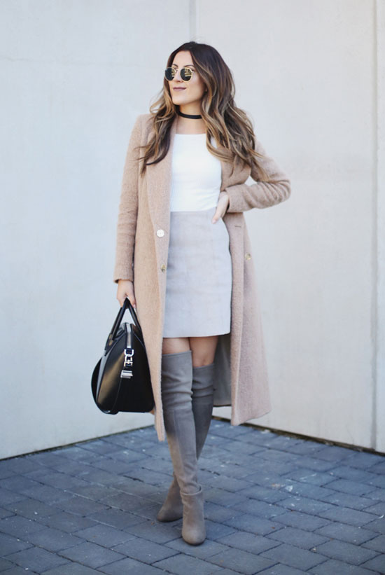 Street Style - The Top Blogger Looks Of The Week: Fashion blogger 'Stephanie Sterjovski' wearing a camel long coat, a white t-shirt, a light grey mini skirt, grey suede over the knee boots, round sunglasses and a black handbag. Fall outfit, spring outfit, boho chic outfit, work outfit, casual outfit.