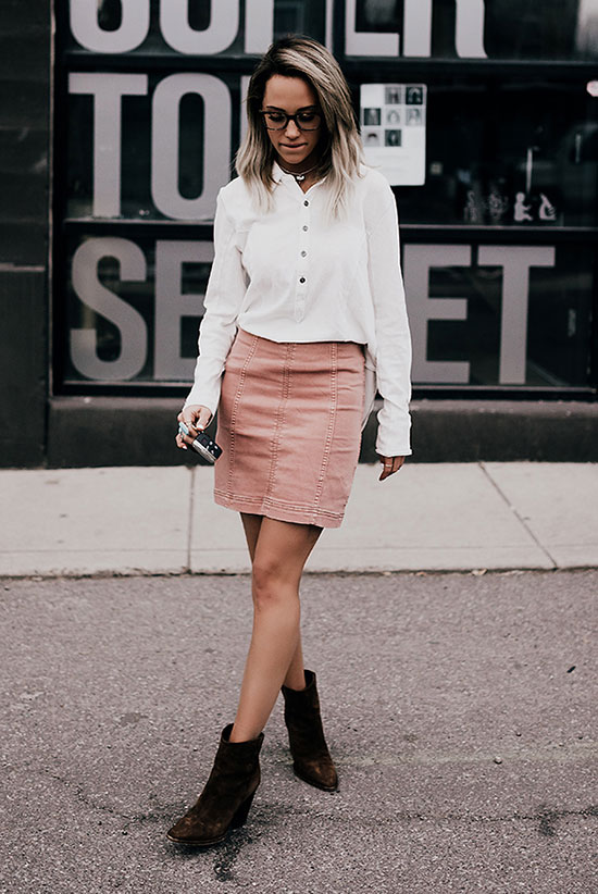 Street Style - The Top Blogger Looks Of The Week: Fashion Blogger 'Style'd Avenue' wearing a white shirt, a blush suede mini skirt and brown suede western booties. Summer outfit, spring outfit, casual outfit, boho outfit, western outfit, boho chic outfit, festival outfit.