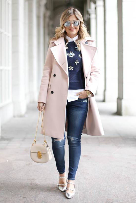 Street Style - The Top Blogger Looks Of The Week: Fashion blogger 'Suburban Faux Pas' wearing a pale pink coat, a white shirt, a navy embellished sweater, skinny jeans, silver flats, pink mirror sunglasses and a pale pink shoulder bag. Casual outfit, fall outfit, winter outfit, street chic style.