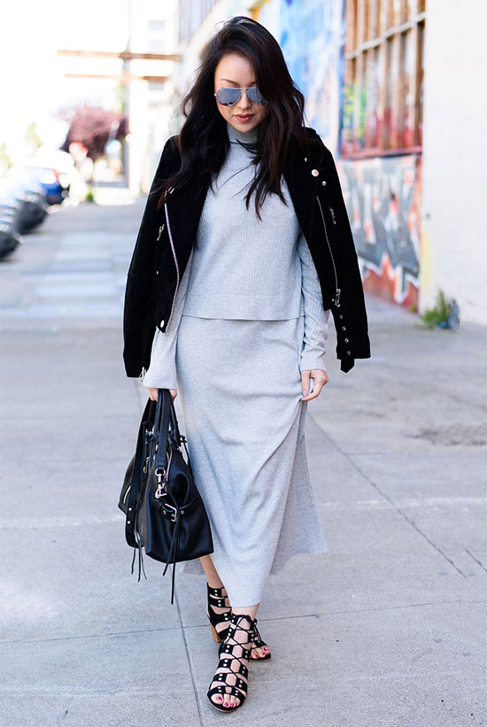 Street Style - The Top Blogger Looks Of The Week: Fashion blogger 'The Fancy Pants Report' wearing a black suede jacket, a grey turtleneck knit top, a grey knit midi skirt, black gladiator sandals, mirror sunglasses and a black handbag. Fall outfit, spring outfit, boho chic outfit, boho outfit, comfy outfit