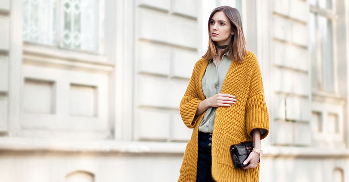 Street Style - The Top Blogger Looks Of The Week: Fashion Blogger 'Fashion Agony' wearing a mustard chunky cardigan, an olive shirt, navy culottes, brown heels and a black clutch. Fall outfit, casual outfit, work outfit, fall work outfit, office outfit, office style, street chic style.