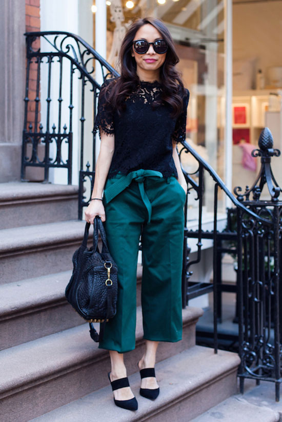 "Street Style - The Top Blogger Looks Of The Week: Fashion Blogger 'The View From 5"" 2'' wearing a black lace short sleeve top, green obi belt culottes, black mule heels, black sunglasses and a black handbag. Spring outfit, summer outfit, night out outfit, work outfit, office outfit, street chic style."