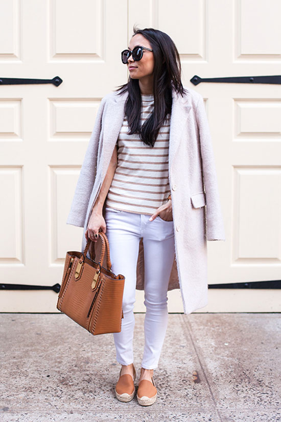 "Street Style - The Top Blogger Looks Of The Week: Fashion blogger 'The View From 5'2""' wearing a cream coat, a brown stripe t-shirt, white skinny jeans, brown espadrilles, black sunglasses and a brown handbag. Casual outfit, spring outfit, comfy outfit"