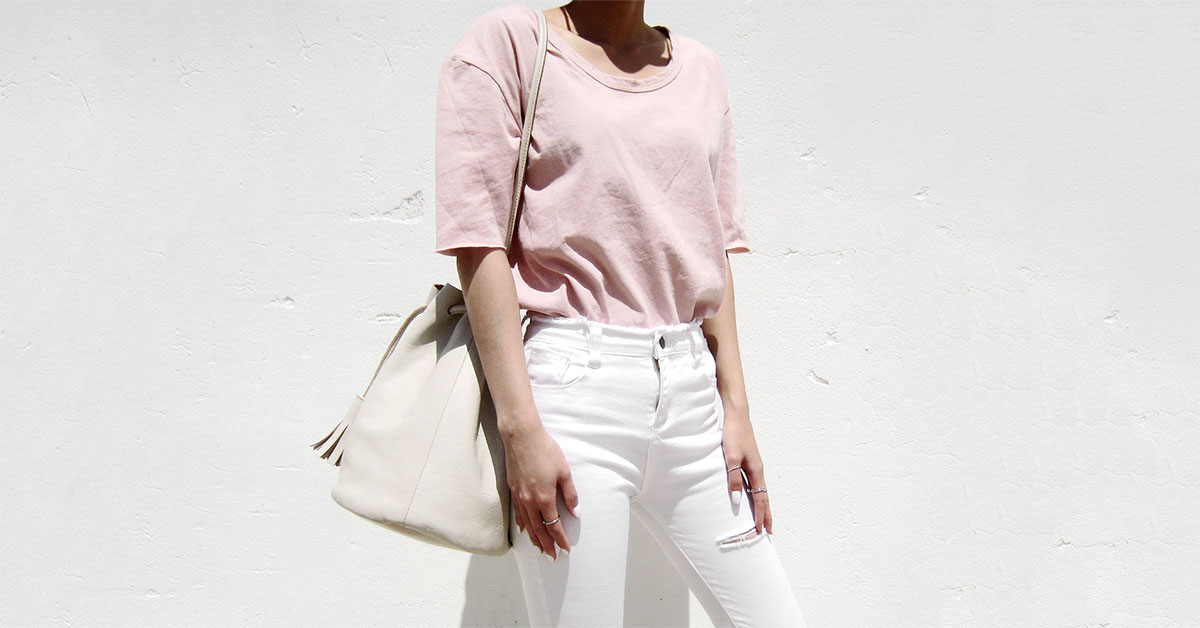 A Simple Way To Freshen Up Those Basics: Fashion blogger '1FINEDAI' wearing a blush t-shirt, white ripped skinny jeans, white sneakers, white sunglasses and a white bucket bag. Spring outfit, summer outfit, casual outfit, comfy outfit, athleisure outfit, street style, sneakers outfit.