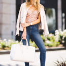 Street Style - The Top Blogger Looks Of The Week: Fashion blogger 'Angel Food Style' wearing a blush leather jacket, a nude lace bustier, crop skinny jeans, metallic mule sandals, black sunglasses and a white tote bag. Spring outfit, summer outfit, party outfit, night out outfit, street chic style.
