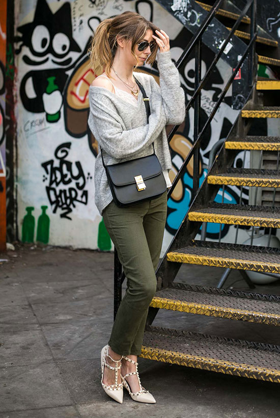 Street Style - The Top Blogger Looks Of The Week: Fashion blogger 'EJ Style' wearing a white v-neck cami top, a grey oversized v-neck sweater, military green ankle pants, nude flats, aviator sunglasses and a black shoulder bag. Spring outfit, fall outfit, street chic style, comfy outfit, casual outfit.