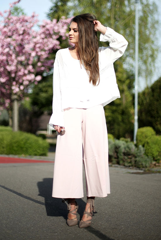 Street Style - The Top Blogger Looks Of The Week: Fashion blogger 'Fashion Hippie Loves' wearing a white relaxed blouse, blush culottes and grey suede lace-up heels. Summer outfit, spring outfit, casual outfit, night out outfit, street chic style.