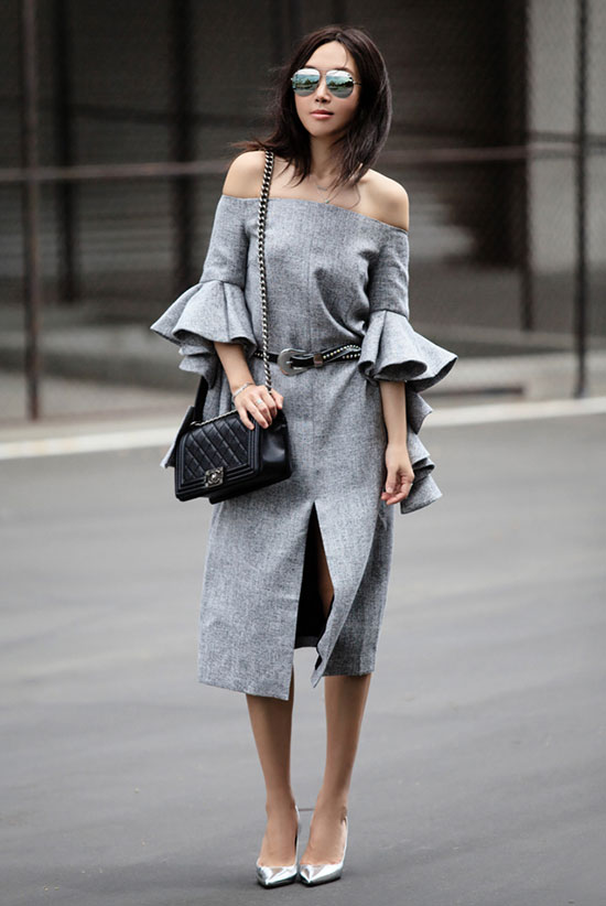 Summer outfits - The Top Blogger Looks Of The Week: Fashion blogger 'Fit Fab Fun Mom' wearing a grey off the shoulder midi dress with ruffle sleeves, a black western belt, silver aviator sunglasses and a black shoulder bag. Spring outfit, fall outfit, street chic style, night out outfit, party outfit.