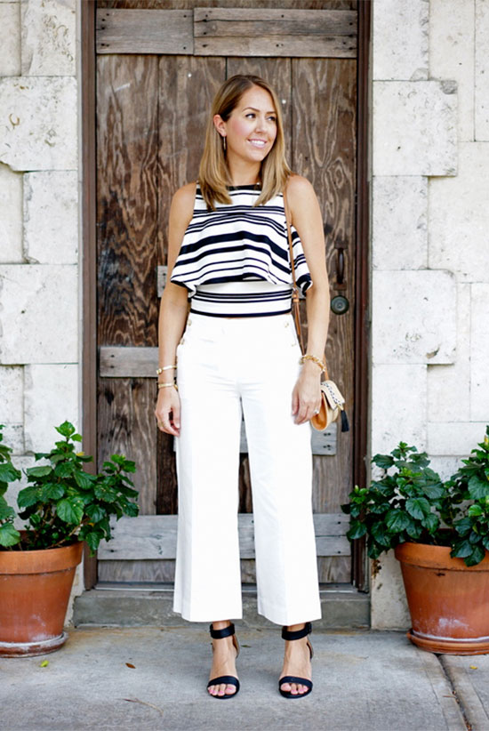Street Style - The Top Blogger Looks Of The Week: Fashion blogger 'J's Everyday Fashion' wearing a black stripe ruffle sleeveless crop top, white culottes, black ankle strap sandals and a white shoulder bag. Summer outfit, night out outfit, casual outfit, comfy outfit, beach outfit, getaway outfit, vacation outfit, street chic style.