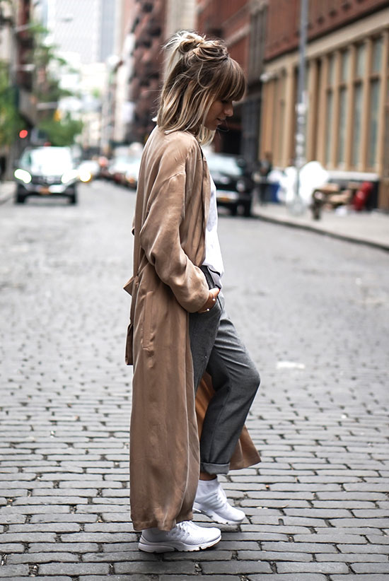 Summer outfits - The Top Blogger Looks Of The Week: Fashion blogger 'Noholita' wearing a blush silk duster coat, a white t-shirt, grey cuffed trousers and white sneakers. Spring outfit, summer outfit, athleisure outfit, sneakers outfit, casual outfit, comfy outfit, street style.