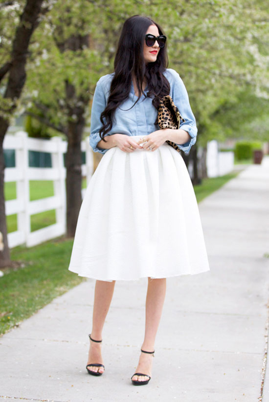 Street Style - The Top Blogger Looks Of The Week: Fashion blogger 'Pink Peonies' wearing a chambray shirt, a white pleated midi skirt, black heeled sandals, black sunglasses and a leopard print clutch. Summer outfit, street chic style, casual outfit, party outfit.