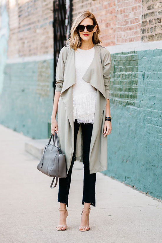 Street Style - The Top Blogger Looks Of The Week: Fashion blogger 'See (anna) Jane' wearing a beige trench coat, a white fringe hem sweater, black crop pants, nude heeled sandals, brown sunglasses and a grey handbag. Spring outfit, spring work outfit, office outfit, casual outfit, trench coat outfit, street chic style.
