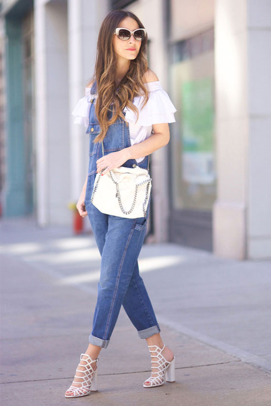 Street Style - The Top Blogger Looks Of The Week: Fashion blogger 'Something Navy' wearing a white off the shoulder top, denim overalls, white heeled sandals, white sunglasses anda white shoulder bag. Summer outfit, casual outfit, street chic style.
