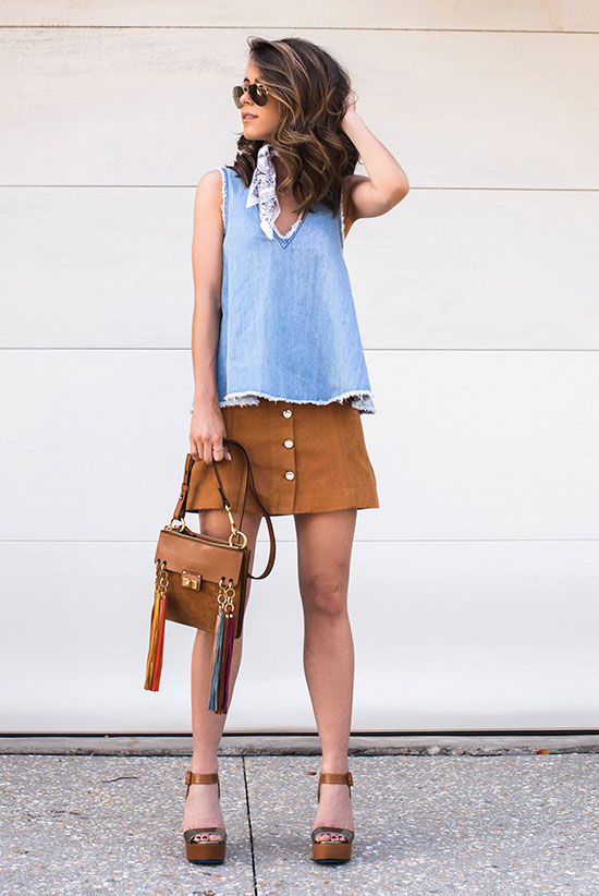 Summer outfits - The Top Blogger Looks Of The Week: Fashion blogger 'The Style Bungalow' wearing a raw hem sleeveless chambray top, a brown suede a-line mini skirt, brown platform sandals, a white bandana, aviator sunglasses and a brown tassel shoulder bag. Summer outfit, casual outfit, street chic style.