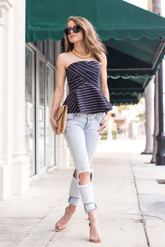 Summer Outfits - The Top Blogger Looks Of The Week: Fashion blogger 'The Style Bungalow' wearing a navy stripe peplum top, light denim distressed skinny jeans, nude heeled sandals, black sunglasses, and a nude cork clutch. Summer outfit, night out outfit, party outfit, street style, street chic style.